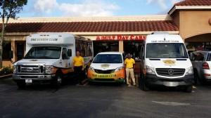 staff standing besides ambulance
